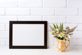 Black brown  landscape frame mockup with chamomile and grass in