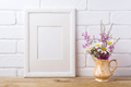White frame mockup with chamomile and purple flowers in golden p
