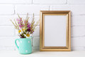 Golden  frame mockup with chamomile and purple flowers in mint g