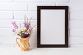 Black brown  frame mockup with chamomile and purple flowers in g
