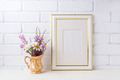 Gold decorated frame mockup with chamomile and purple flowers in