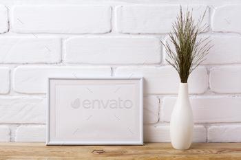 White landscape frame mockup with dark grass in elegant vase