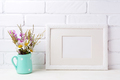 White landscape frame mockup with chamomile and purple flowers i