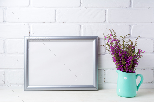 Silver landscape frame mockup with maroon purple flowers in mint - Stock Photo - Images