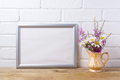 Silver landscape frame mockup with chamomile and purple flowers