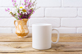 White coffee mug mockup with chamomile and purple flowers in gol - PhotoDune Item for Sale