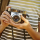 Backpacker with vintage camera in the countryside. Travel background. Lifestyle - PhotoDune Item for Sale