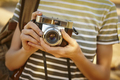 Backpacker with vintage camera in the countryside. Travel background. Lifestyle