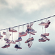 Old shoes hang on wire. - PhotoDune Item for Sale