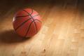 Basketball on Hardwood Court Floor with Spot Lighting - PhotoDune Item for Sale