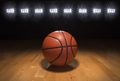 Basketball on Hardwood Court Floor with Dark Background and Lights