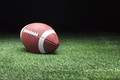 College Style Football on Field with Dark Barkground - PhotoDune Item for Sale