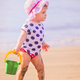 Little girl playing on the beach - PhotoDune Item for Sale