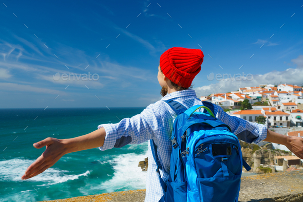 Woman with a backpack behind her back is spinning her arms out t - Stock Photo - Images