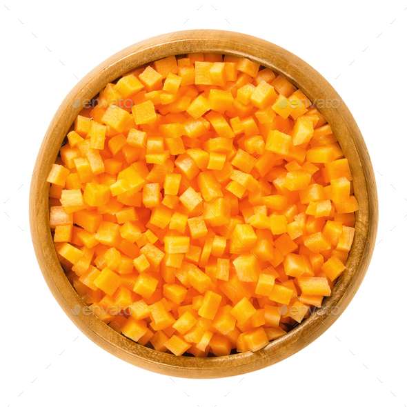 Carrot cubes in wooden bowl over white - Stock Photo - Images