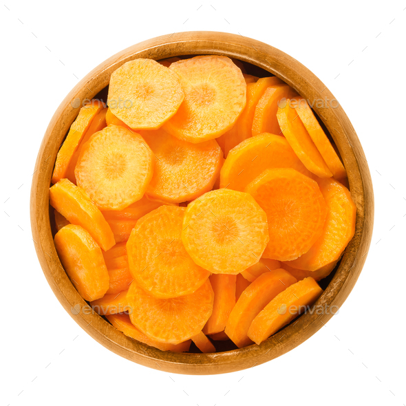 Carrot slices in wooden bowl over white - Stock Photo - Images