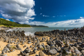 Stacked balancing rocks on the beach between Cairns and Port Dou - PhotoDune Item for Sale