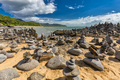 Stacked balancing rocks on the beach between Cairns and Port Dou