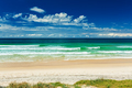 Empty beach with grass strip and breaking waves, Gold Coast