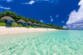 Tropical beach with with palm trees and villas, Polynesia - PhotoDune Item for Sale
