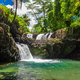 Vibrant Togitogiga falls with swimming hole on Upolu, Samoa - PhotoDune Item for Sale