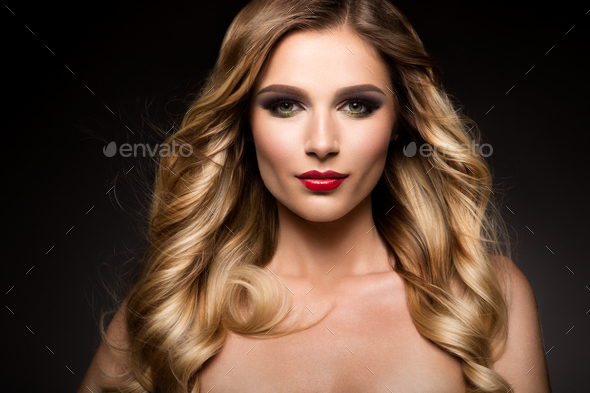 Beautiful blonde model girl with long curly hair . Hairstyle wavy curls . Red lips. - Stock Photo - Images