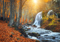Waterfall at mountain river in autumn forest at sunset. - PhotoDune Item for Sale