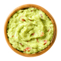 Guacamole, avocado dip, in wooden bowl