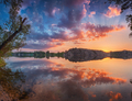 Beautiful panoramic landscape with colorful cloudy sky, lake and
