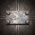 Old metal plate on metallic wall