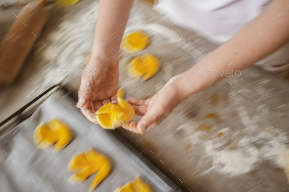 female woman artisan baker at home baking a sweet dough cookies - Stock Photo - Images