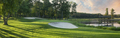 Panorama of Golf Green and Sand Traps in Late Sunlight