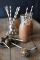 Bottles of chocolate milk and cake pops on plate - PhotoDune Item for Sale
