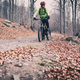 Mountain biker riding on trail in autumn woods - PhotoDune Item for Sale