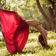 Fit young beautiful woman wearing red skirt working out outdoors in park on summer day - PhotoDune Item for Sale