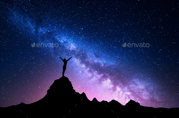 Milky Way with  silhouette of a standing happy girl