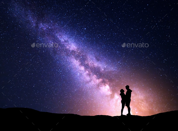 Milky Way with silhouette of people. Landscape with night sky - Stock Photo - Images