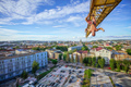 Urban climbing: rock climber hanging upside down on jib of construction crane