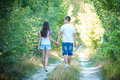 Young couple on walk in summer forest