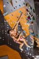 Young man falling down while being belayed in indoor climbing gym - PhotoDune Item for Sale