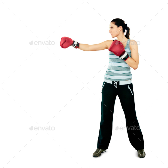 Boxer woman during boxing exercise, isolated on white