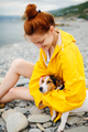 Girl with dog on beach
