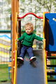One year old baby boy toddler wearing green sweater at playground - PhotoDune Item for Sale