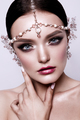 Portrait of a beautiful fashion brunette bride, sweet and sensual. Wedding make up and hair.
