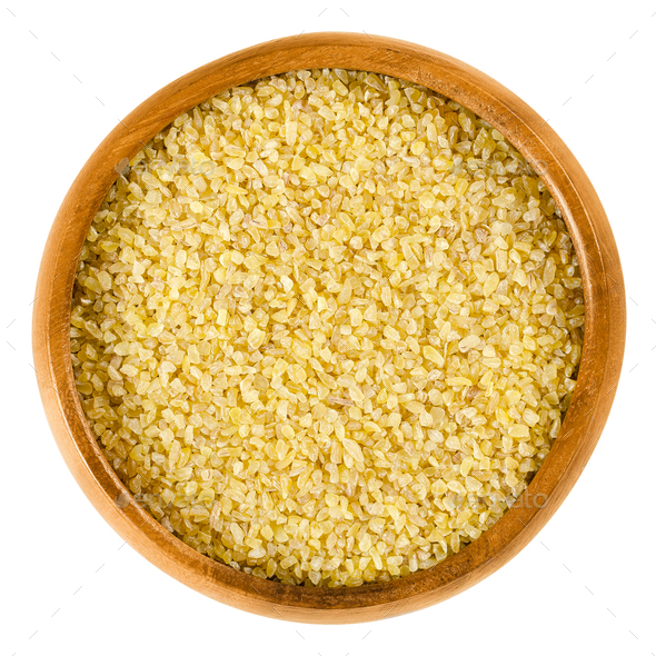 Uncooked bulgur or burghul in wooden bowl - Stock Photo - Images