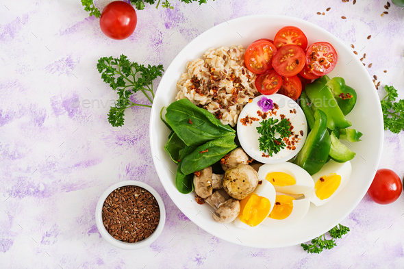 Oatmeal porridge, egg and fresh vegetables - tomatoes, spinach, paprika,  mushrooms  - Stock Photo - Images