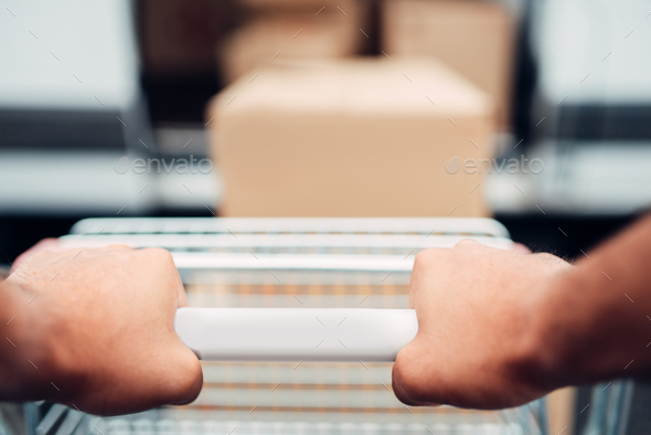 Male hands with cargo trolley, cargo delivery - Stock Photo - Images