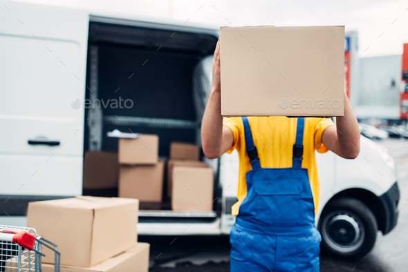 Worker holds carton box, distribution business - Stock Photo - Images