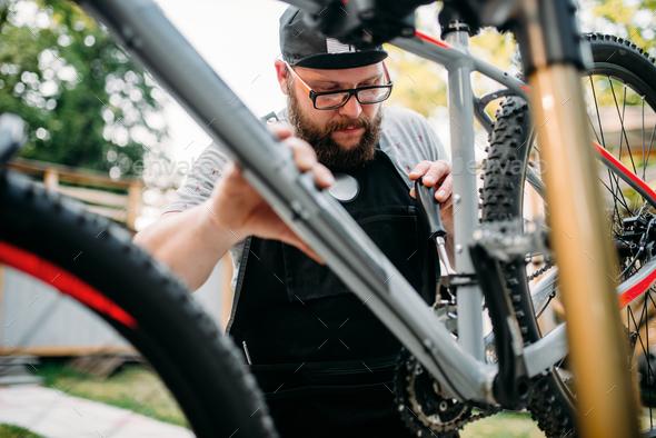 Bicycle mechanic repair bike, cycle workshop - Stock Photo - Images
