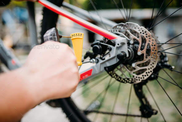 Bicycle mechanic hands with service tools - Stock Photo - Images